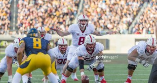 BERKELEY, CA -  NOVEMBER 22:  Quarterback Kevin Hogan #8 of the Stanford Cardinal calls signals during a PAC-12 NCAA football game against the California Golden Bears in the 117th Big Game played on November 22, 2014 at Memorial Stadium on the University of California campus in Berkeley, California.   Also visible are fullback Lee Ward #36, center Graham Shuler #52,  and offensive lineman Joshua Garnett #51.  (Photo by David Madison/Getty Images) *** Local Caption *** Kevin Hogan