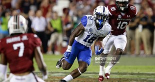 Kentucky running back Stanley Williams (18) picks up some of his 107 rushing yards against South Carolina in the fourth quarter at Williams-Brice Stadium in Columbia, S.C., on Saturday, Sept. 12, 2015. Kentucky won, 26-22. (Mark Cornelison/Lexington Herald-Leader/TNS)