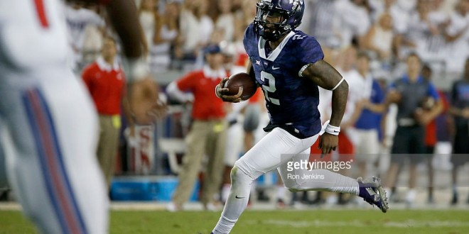FORT WORTH, TX - SEPTEMBER 19: Trevone Boykin #2 of the TCU Horned Frogs takes off on a touchdown run in the second quarter against the Southern Methodist Mustangs at Amon G. Carter Stadium on September 19, 2015 in Fort Worth, Texas. (Photo by Ron Jenkins/Getty Images)