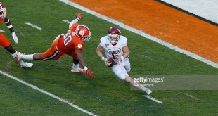 MIAMI GARDENS, FL - DECEMBER 31: Baker Mayfield #6 of the Oklahoma Sooners is pursued by Kevin Dodd #98 of the Clemson Tigers as he runs with the ball in the first quarter during the 2015 Capital One Orange Bowl at Sun Life Stadium on December 29, 2015 in Miami Gardens, Florida. Clemson defeated Oklahoma 37-17. (Photo by Joel Auerbach/Getty Images) *** Local Caption *** Kevin Dodd;Baker Mayfield