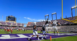 FORT WORTH, TX - SEPTEMBER 17:  Kyle Hicks #21 of the TCU Horned Frogs celebrates with teammates after scoring a touchdown in the first half at Amon G. Carter Stadium on September 17, 2016 in Fort Worth, Texas. (Photo by Ron Jenkins/Getty Images)