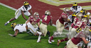 MIAMI GARDENS, FL - DECEMBER 30: Dalvin Cook #4 of the Florida State Seminoles scores a first quarter touchdown against the Michigan Wolverines during the 2016 Capital One Orange Bowl at Hard Rock Stadium on December 30, 2016 in Miami Gardens, Florida. Florida State defeated Michigan 33-32. (Photo by Joel Auerbach/Getty Images) *** Local Caption *** Dalvin Cook