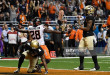 SAN ANTONIO, TX - December 29: Oklahoma State Cowboys wide receiver James Washington #28 celebrates his touchdown against Colorado Buffaloes defensive back Chidobe Awuzie #4 and Colorado Buffaloes defensive back Tedric Thompson #9 in the second quarter during the Valero Alamo Bowl at the Alamodome December 29, 2016. (Photo by Andy Cross/The Denver Post)