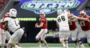 ARLINGTON, TX - JANUARY 02: Bart Houston #13 of the Wisconsin Badgers looks to throw in the fourth quarter during the 81st Goodyear Cotton Bowl Classic between Western Michigan and Wisconsin at AT&T Stadium on January 2, 2017 in Arlington, Texas.  (Photo by Ronald Martinez/Getty Images)