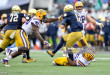 ORLANDO, FL - JANUARY 01: Notre Dame Fighting Irish quarterback Ian Book (12) is sacked by LSU Tigers nose tackle Ed Alexander (95) during the first half of the Citrus Bowl game between the Notre Dame Fighting Irish and the LSU Tigers on January 01, 2018, at Camping World Stadium in Orlando, FL. Notre Dame leads 3-0 at half. (Photo by Roy K. Miller/Icon Sportswire)