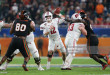MIAMI GARDENS, FL - DECEMBER 30: Alex Hornibrook #12 of the Wisconsin Badgers throws the ball against the Miami Hurricanes during the 2017 Capital One Orange Bowl at Hard Rock Stadium on December 30, 2017 in Miami Gardens, Florida. Wisconsin defeated Miami 34-24. (Photo by Joel Auerbach/Getty Images) *** Local Caption *** Alex Hornibrook