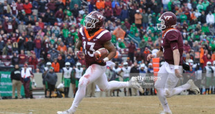 BLACKSBURG, VA - DECEMBER 1: Running back Jalen Holston #13 of the Virginia Tech Hokies rushes for a touchdown against the Marshall Thundering Herd in the second half at Lane Stadium on December 1, 2018 in Blacksburg, Virginia. (Photo by Michael Shroyer/Getty Images)